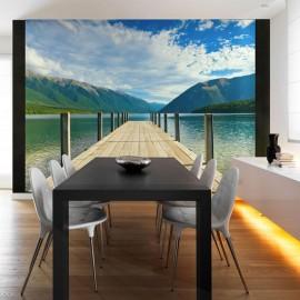 Fotomural - Un puente de un lago montañés