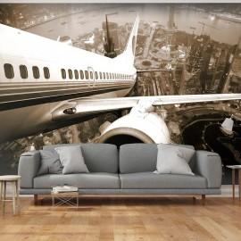 Fotomural - Avião decolando da cidade