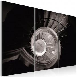Quadro - Down a spiral staircase